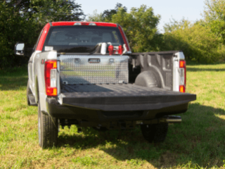 Ford F150 with custom bed liner, transfer tank, and pick-up tool box. Equipped and assemnled by TiNik, INC.